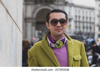 MILAN, ITALY - FEBRUARY 28: Man poses outside Gabriele Colangelo fashion show building for Milan Women's Fashion Week on FEBRUARY 28, 2015  in Milan.