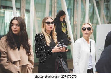 MILAN, ITALY - FEBRUARY 28: People during Milan Fashion week, Italy on February, 28 2015. Eccentric and fashionable people outside city during Milan fashion week wait for models and famous people