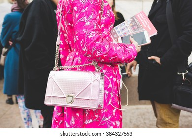 MILAN, ITALY - FEBRUARY 29, 2016: Close up on the eccentric dress of a woman attending models and vips in the streets during Milan Fashion Week Women Fall/Winter 2016/2017