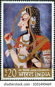 Milan, Italy - February 3, 2018: Indian painting of a princess on postage stamp