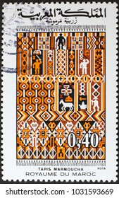 Milan, Italy - February 3, 2018: Carpet Marmoucha on moroccan postage stamp