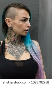 MILAN, iTALY - FEBRUARY 9, 2018: Beautiful tattooed girl poses at Milan Tattoo Convention, international annual event dedicated to tattoos and body painting in Milan, Italy.
