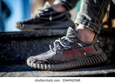 Milan, Italy - January 01, 2018: Man wearing a pair of Adidas Yeezy in the street