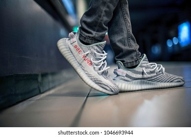 Milan, Italy - January 01, 2018: Man wearing a pair of Adidas Yeezy in the subway
