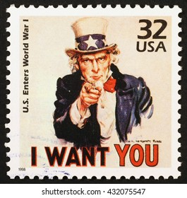 """Milan, Italy - January 08, 2014: american postage stamp reproducing a famous poster to recruit soldiers for World War I: Uncle Sam who says """"I want YOU"""""""