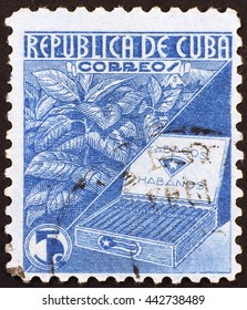 Milan, Italy - January 08, 2015: Cuban vintage postage stamp on tobacco industry