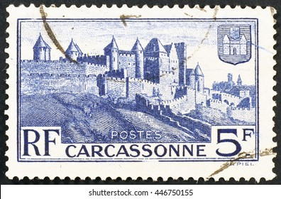 Milan, Italy - january 09, 2014: Beautiful vintage postage stamp with french town of Carcassonne