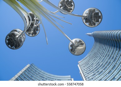 MILAN, ITALY - JANUARY 10, 2017: Artemide LED street lights in Gae Aulenti square, Milan and Unicredit Tower skyscraper