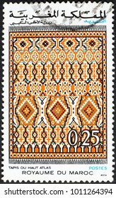 Milan, Italy - January 10, 2018: Carpet of high Atlas on moroccan postage stamp