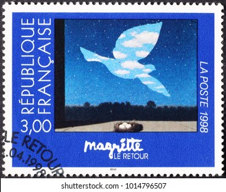 Milan, Italy - January 11, 2018: Famous painting by Magritte on french postage stamp