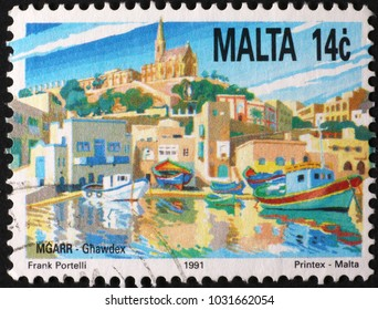 Milan, Italy - January 11, 2018: Harbor in Malta on postage stamp