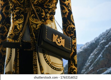 Milan, Italy - January 11, 2020: Black and golden Versace leather purse detail on a mannequin