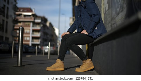 Milan, Italy - January 12, 2019: Young man wearing  Nike Air Force One high shoes in the street - illustrative editorial