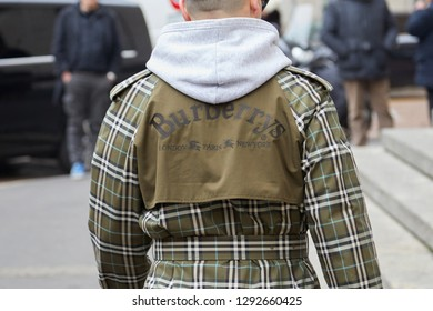 MILAN, ITALY - JANUARY 12, 2019: Man with olive green checkered Burberry coat before Frankie Morello fashion show, Milan Fashion Week street style