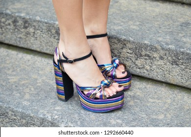 MILAN, ITALY - JANUARY 12, 2019: Woman with purple, blue and golden metallic high heel shoes before Frankie Morello fashion show, Milan Fashion Week street style