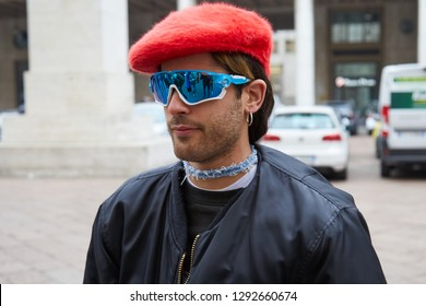 MILAN, ITALY - JANUARY 12, 2019: Man with red hat and blue Oakley sunglasses before Frankie Morello fashion show, Milan Fashion Week street style