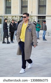 MILAN, ITALY - JANUARY 12, 2019: Alex Badia with white Nike shoes before Neil Barrett fashion show, Milan Fashion Week street style