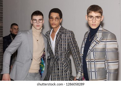 MILAN, ITALY - JANUARY 12: Beautiful models pose in the backstage just before Miguel Vieira show during Milan Men's Fashion Week on JANUARY 12, 2019 in Milan.