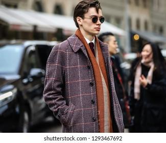 MILAN, Italy- January 13 2019: Men on the street during the Milan Fashion Week.