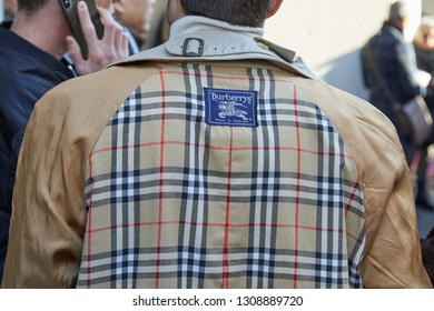 MILAN, ITALY - JANUARY 13, 2019: Man with beige Burberry trench coat before John Richmond fashion show, Milan Fashion Week street style