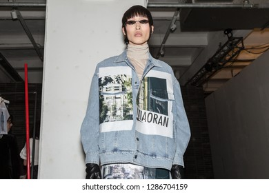 MILAN, ITALY - JANUARY 13: Beautiful model poses in the backstage just before Miaoran show during Milan Men's Fashion Week on JANUARY 13, 2019 in Milan.