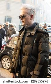 MILAN, ITALY - JANUARY 13: Fashionable man poses outside John Richmond fashion show during Milan Men's Fashion Week on JANUARY 13, 2019 in Milan.