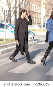MILAN, ITALY - JANUARY 14 2017: Fashionable man poses before EMPORIO ARMANI fashion show during Milan Men Fashion Week, street style on JANUARY 14, 2017 in Milan.