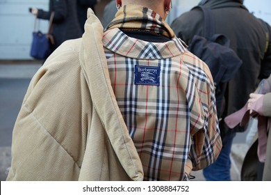MILAN, ITALY - JANUARY 14, 2019: Man with beige Burberry checkered shirt and velvet jacket before Spyder fashion show, Milan Fashion Week street style