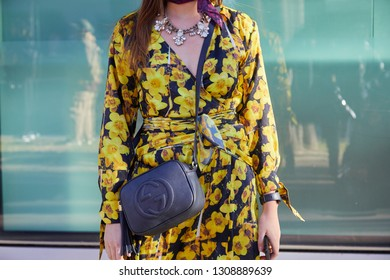 9bb5b077d0f MILAN, ITALY - JANUARY 14, 2019  Woman with yellow floral dress and blue