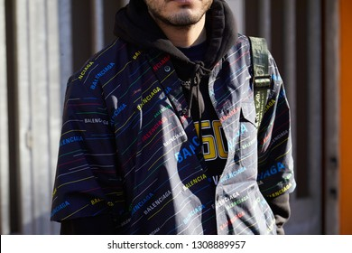 MILAN, ITALY - JANUARY 14, 2019: Man with black Balenciaga shirt with colorful logos before Emporio Armani fashion show, Milan Fashion Week street style