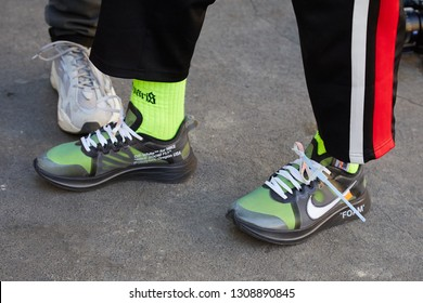 MILAN, ITALY - JANUARY 14, 2019: Man with Nike foam transparent sneakers with yellow socks before Fendi fashion show, Milan Fashion Week street style