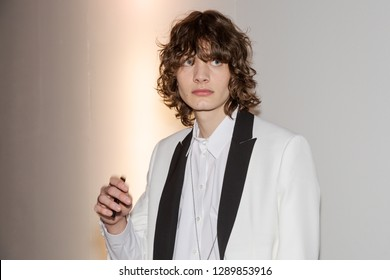 MILAN, ITALY - JANUARY 14: Beautiful model poses in the backstage just before Isabel Benenato show during Milan Men's Fashion Week on JANUARY 14, 2019 in Milan.