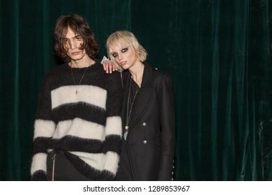 MILAN, ITALY - JANUARY 14: Beautiful models pose in the backstage just before Isabel Benenato show during Milan Men's Fashion Week on JANUARY 14, 2019 in Milan.