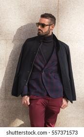 MILAN, ITALY - JANUARY 14: Fashionable man poses outside Antonio Marras fashion show building during Milan Men's Fashion Week on JANUARY 14, 2017 in Milan.
