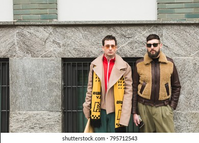 MILAN, ITALY - JANUARY 15: Fashionable people pose outside Armani fashion show during Milan Men's Fashion Week on JANUARY 15, 2018 in Milan.
