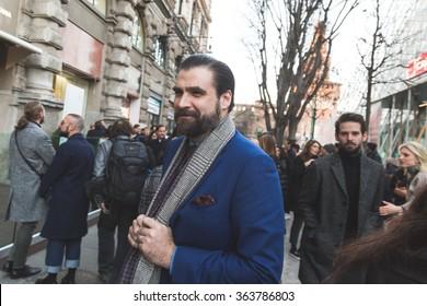 MILAN, ITALY - JANUARY 16: People gather outside Jil Sander fashion show building for Milan Men's Fashion Week on JANUARY 16,2016 in Milan.
