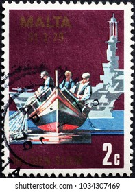 Milan, Italy - January 18, 2018: Maltese fisheremen and typical boat on postage stamp