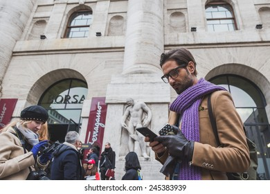 MILAN, ITALY - JANUARY 18: People gather outside Ferragamo fashion show building for Milan Men's Fashion Week on JANUARY 18, 2015 in Milan.
