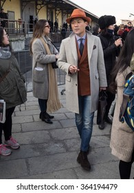 MILAN, ITALY - JANUARY 18: People arrive at the location where there will be the fashion show of Gucci for the Milan Men's Fashion Week on JANUARY 18, 2016 in Milan.