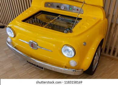 Milan, Italy - January 19, 2018: Smeg fridge in body of vintage Fiat 500 car, Smeg is an Italian manufacturer of upmarket domestic appliances