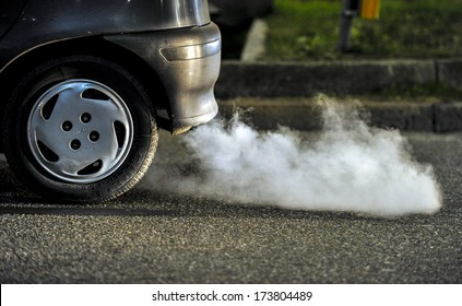 MILAN, ITALY - JANUARY 19: Close up of a car's fumes emissions in the traffic jam in Milan January 19, 2011.