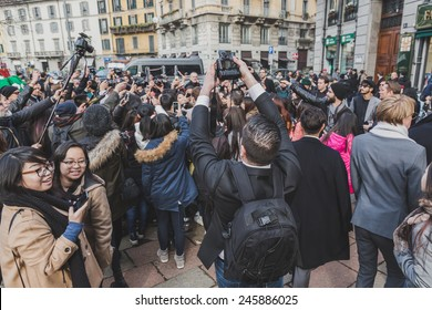 MILAN, ITALY - JANUARY 19: Crowd outside Gucci fashion show building for Milan Men's Fashion Week on JANUARY 19, 2015 in Milan.