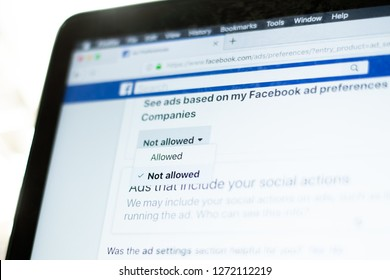 """Milan, Italy - January 2, 2019:  User moves and hovers the mouse pointer over the """"Not allowed"""" selection of the Facebook ads settings on a Facebook page."""