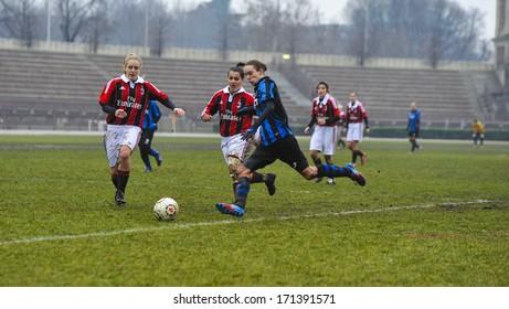 MILAN, ITALY - JANUARY 20: Amateur Female Soccer League match, in Milan, January 20, 2013. AC Milan vs Inter Milan.