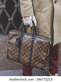MILAN, ITALY - JANUARY 20: Detail of a Louis Vuitton bag outside Cavalli fashion show building for Milan Men's Fashion Week on JANUARY 20, 2015 in Milan.