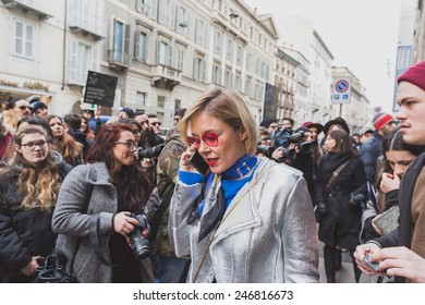 MILAN, ITALY - JANUARY 20: People gather outside Cavalli fashion show building for Milan Men's Fashion Week on JANUARY 20, 2015 in Milan.