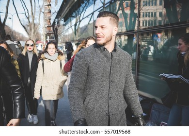 MILAN, ITALY - JANUARY, 2017: People, stylists, models, fashion bloggers and photographer in the street during Man's Milan Fashion Week fall/winter 2017/2018