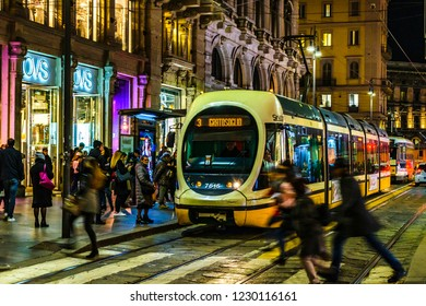 MILAN, ITALY, JANUARY - 2018 - Urban street scene with modern train crossing the street at historic center of milan city, Italy