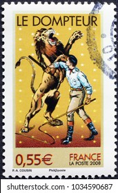 Milan, Italy - January 22, 2018: Tamer of lions on french postage stamp