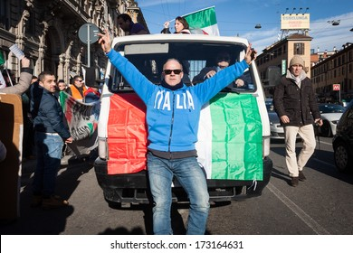 MILAN, ITALY - JANUARY 25: Demonstrators of the so-called December 9 movement march in the city streets to protest against government and political class on JANUARY 25, 2013 in Milan.